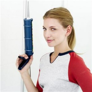 woman with caulking gun