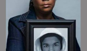 Mother holding picture of Trayvon